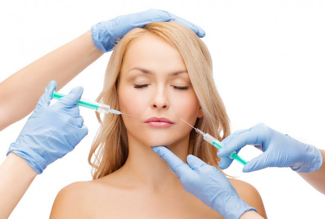 photodune-7064054-woman-face-and-beautician-hands-with-syringes-m-46310-636x0